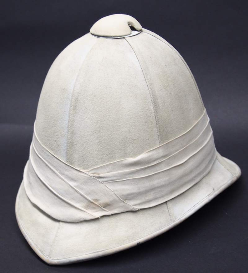 14a29aed49491 This is a truly unique piece. It is a London-made Foreign Service Helmet,  and it likely dates to the Boer War era. It features the usual six panels  ...